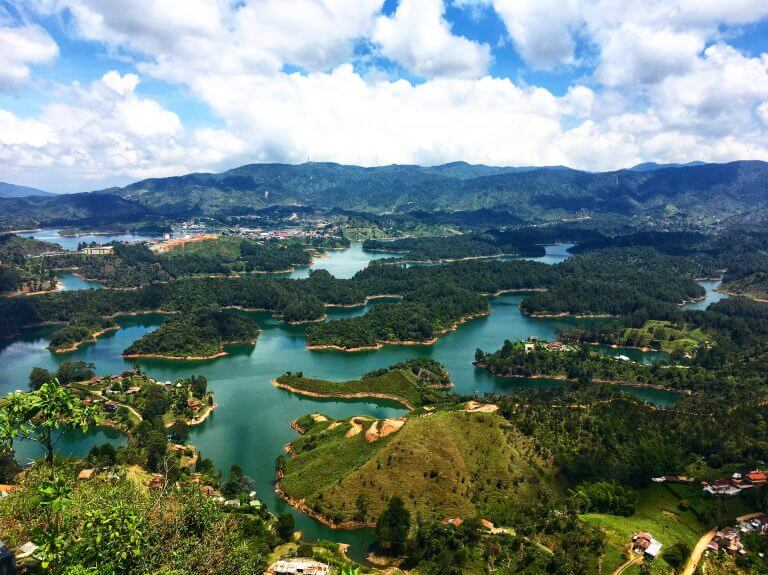 Guatape Colombia from above. Picture of multiple man-made islands surrounded by a beautiful blue lake.