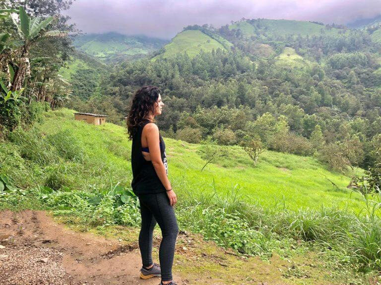 Girl standing on mountain in Piura Peru