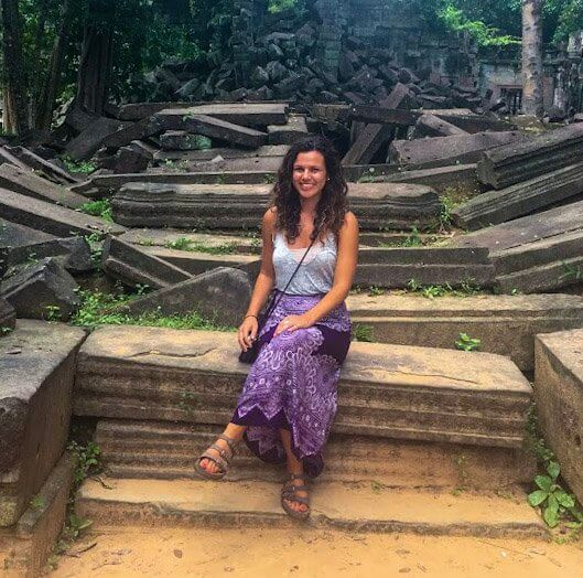 Girl who wrote Cambodia Travel Guide pictured in front of Cambodian ruins.