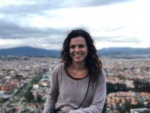 Picture of a girl who wrote Ecuador travel guide in front of a mountain in Cuenca Ecuador.