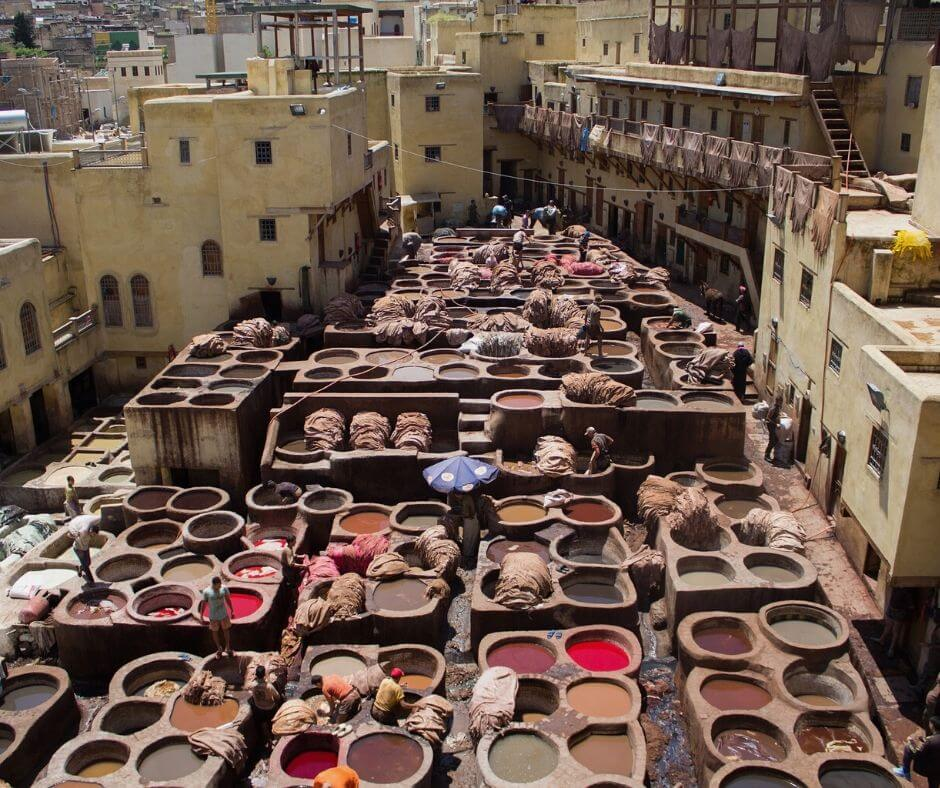 Moroccan scam in Morocco displayed. Scam inside a Moroccan tannery. Picture displays paints and leathers inside a tannery.