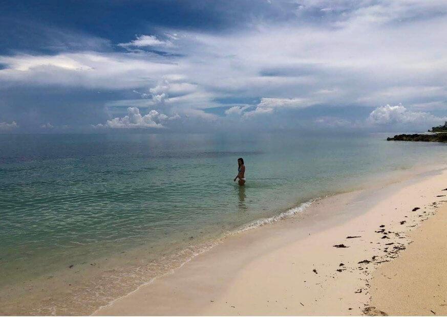 Girl in the blue sea on Grand Bahama Island