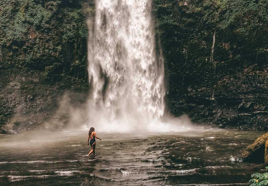 Girl at waterfall in Bali, Indonesia