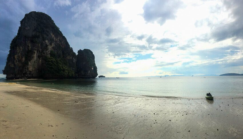 Thailand Beach near Krabi, Thailand. Picture of a boat with an island in the background.