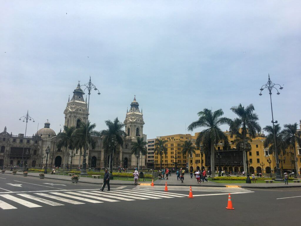 The Historic Center in Lima, Peru. Buildings and someone crossing street.