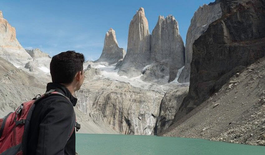 Nomadic Matt - a famous travel blogger in front of a beautiful landscape