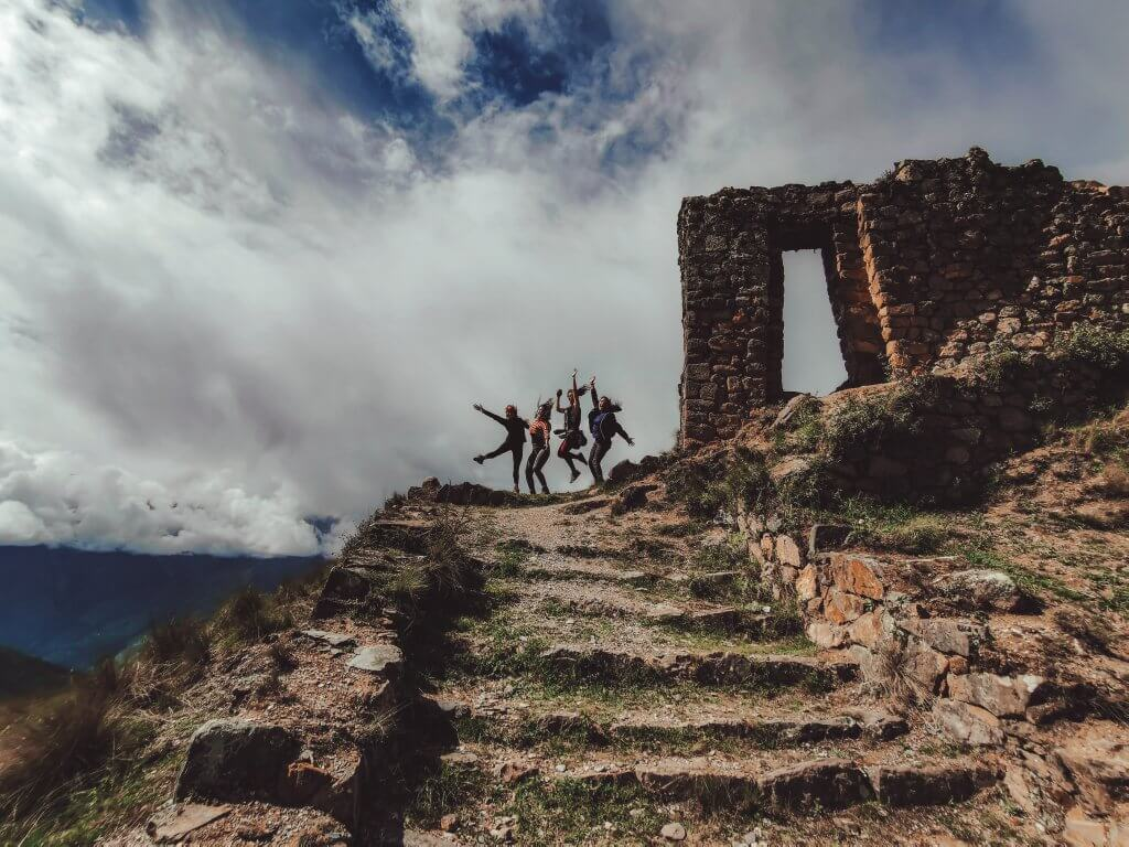Group of 4 people at the Sun Gate at Machu Picchu