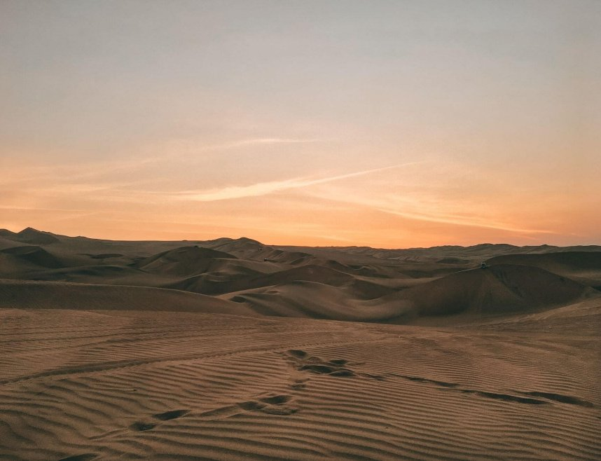 Huacachina Desert Oasis Picture of sun setting over the sand dunes in Peru